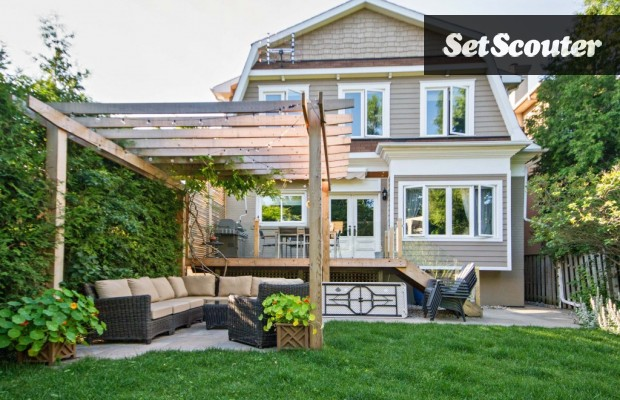 Dorin's backyard haven is a source of great pride in her home. The back deck and pergola were custom built and look gorgeous against the manicured lawn. The space is wide and can host several outdoor scenes.